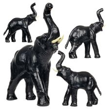 Free Set Of Black Leather Elephant Figurines Royalty Free Stock Photos - 24976598