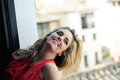 Free Blonde Woman In A Window Wearing A Red Dress Stock Photos - 24998723