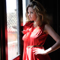 Free Blonde Woman In A Window Wearing A Red Dress Royalty Free Stock Image - 24998726