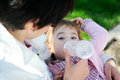 Free Mother Feeding Her Baby Girl With Feeding Bottle Stock Image - 24998771