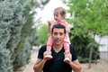Free Baby Girl Walking On The Shoulders Of Her Father Royalty Free Stock Images - 24999049
