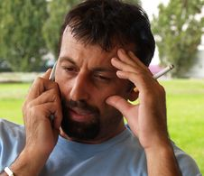 Sports Agent Stressful Phone Call Royalty Free Stock Images