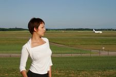 Free Portrait Of Woman With A Plane Stock Photography - 2502442