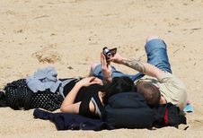Free Couple With Camcorder At Beach Stock Photos - 2508513