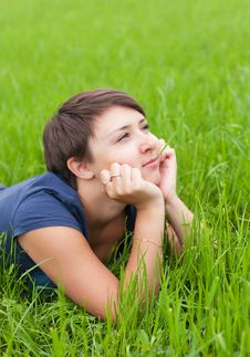 Free Young Woman Relaxing On The Green Grass Stock Photos - 25003023