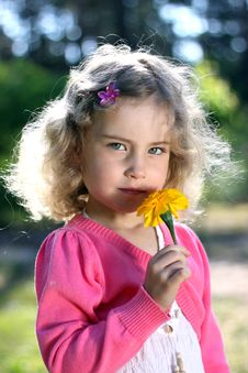 Free Lovely Girl With A Flower Royalty Free Stock Image - 25004226