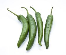 Green Chilli On The White Background Stock Images