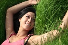 Free Beautiful Young Woman Lying On Grass Stock Images - 25005344