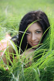 Free Beautiful Young Woman Lying On Grass Stock Photography - 25005352