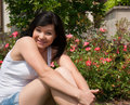 Free Young Pretty Woman Smiling In The Garden Royalty Free Stock Photography - 25017797