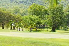 Golf Green Beside The Mountain Royalty Free Stock Photo