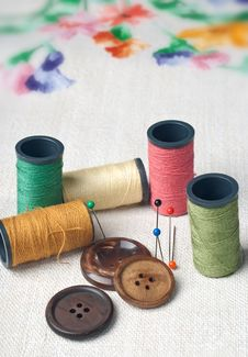 Many Bobbin Of Thread With Needle And Button Royalty Free Stock Photography