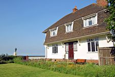 Free Holiday Cottage By The Sea Stock Image - 25018481