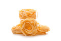Free THREE UNCOOKED PASTA NESTS Stock Photography - 25034432