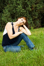 Free Woman Sitting On The Green Grass Stock Images - 25035464