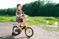 Free Little Boy Riding Bike On Country Stock Photos - 25037643