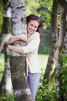 Free Woman Embracing A Birch Royalty Free Stock Images - 25031609