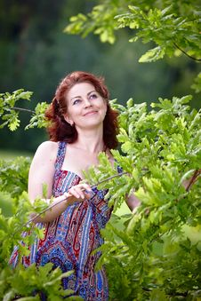 Free Woman With Oak Branches Royalty Free Stock Photos - 25031718