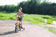 Free Little Boy Riding Bike On Country Stock Photo - 25037660