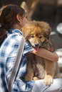 Free Girl Hugs Her Puppy Stock Photography - 25044862
