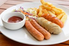 Mixed Sausage Served With French Fried Royalty Free Stock Photo