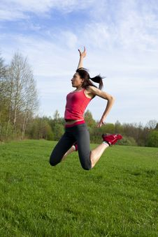 Free Athletic Woman Jumping In The Park Stock Photos - 25046013