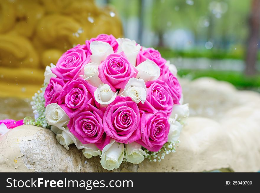 Flowers roses wedding bouquet in fountain sprays water droplets