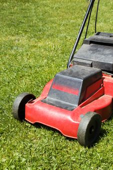 Free Lawnmower On Green Grass Royalty Free Stock Image - 25050486
