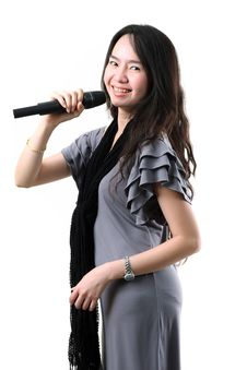 Free Karaoke Singer On A White Background. Royalty Free Stock Photo - 25061965