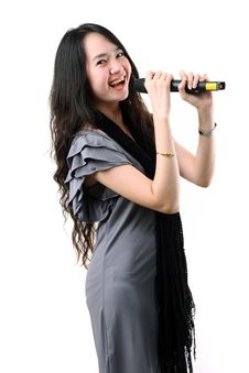 Free Karaoke Singer On A White Background. Royalty Free Stock Images - 25061979