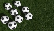 Free Soccer Balls On A Green Grass Royalty Free Stock Photography - 25064047