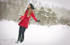 Free Happy Girl With Cap And Gloves Playing With Snow Royalty Free Stock Photography - 25070367