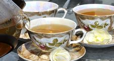 Free Pouring Tea From Porcelain Tea-kettle Into Cup. Royalty Free Stock Image - 25070446