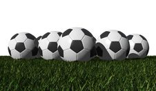 Free Soccer Balls On A Green Grass Royalty Free Stock Photo - 25092895