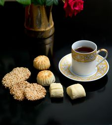 Oriental Cookies And Cup Stock Photos