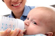 Free Adorable Baby Drinking A Bottle Royalty Free Stock Photo - 25097005