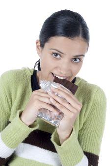 Girl With Chocolate Stock Images