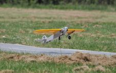 Free Yellow Model Plane Flying Royalty Free Stock Image - 25113326