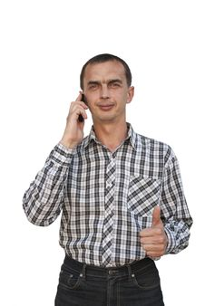 A Young Man Talking On The Phone Stock Images