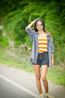 An Attractive Hitchhiker Girl Royalty Free Stock Image