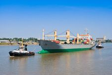 Free Cargo Ship With Two Tugboat Royalty Free Stock Images - 25125329