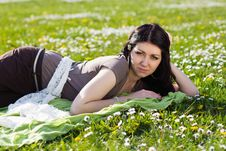 Free Beautiful Girl Lying On The Grass With Flowers Royalty Free Stock Photography - 25126207