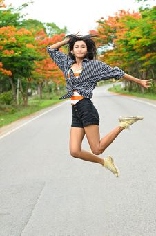 Free An Attractive Hitchhiker Girl Jumping Royalty Free Stock Image - 25126276