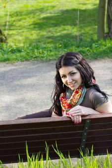 Free Young Woman Sitting On A Bench Royalty Free Stock Images - 25126909
