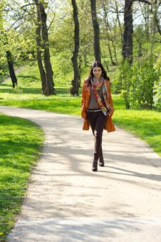 Young Woman Walking In A Park Royalty Free Stock Photography