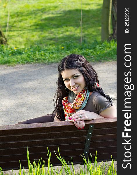 Young woman sitting on a bench