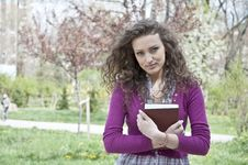 Free Young Student In Park With Book Royalty Free Stock Photos - 25136808