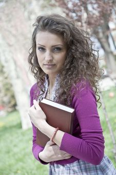 Free Young Student In Park With Book Royalty Free Stock Photo - 25136865