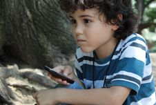 Free Curly Boy With Cellphone Stock Photo - 25142260