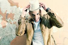 Attractive Man With A Hat In Urban Background Royalty Free Stock Image